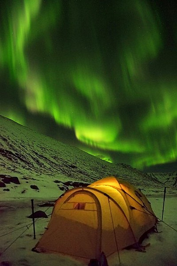 tent under Northern Lights in Iceland